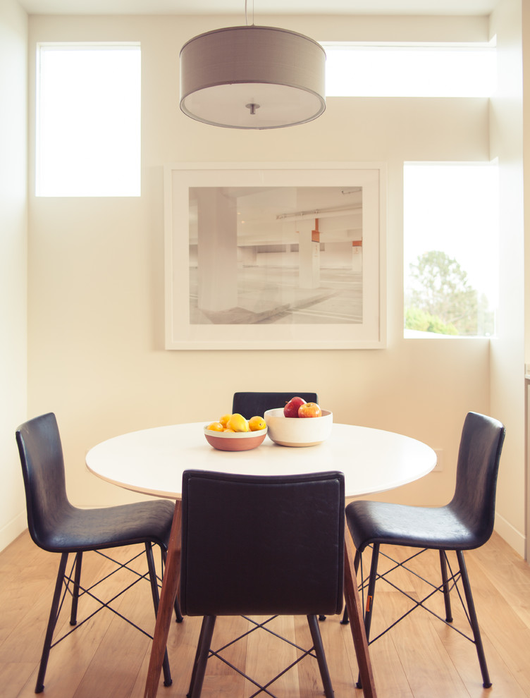 Example of a small trendy medium tone wood floor enclosed dining room design in Los Angeles