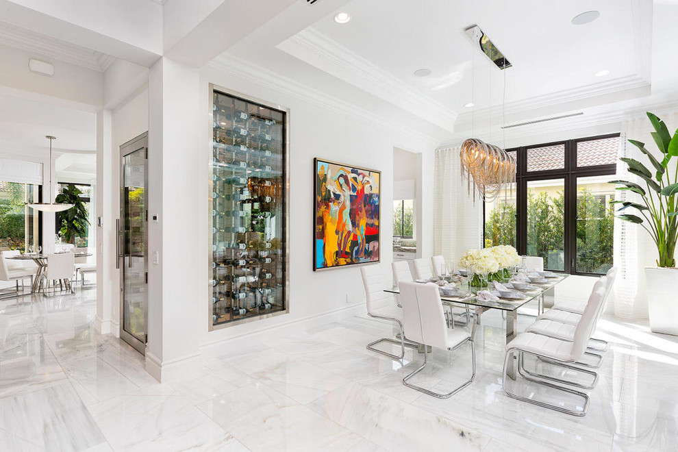 Example of a trendy dining room design in Miami with white walls