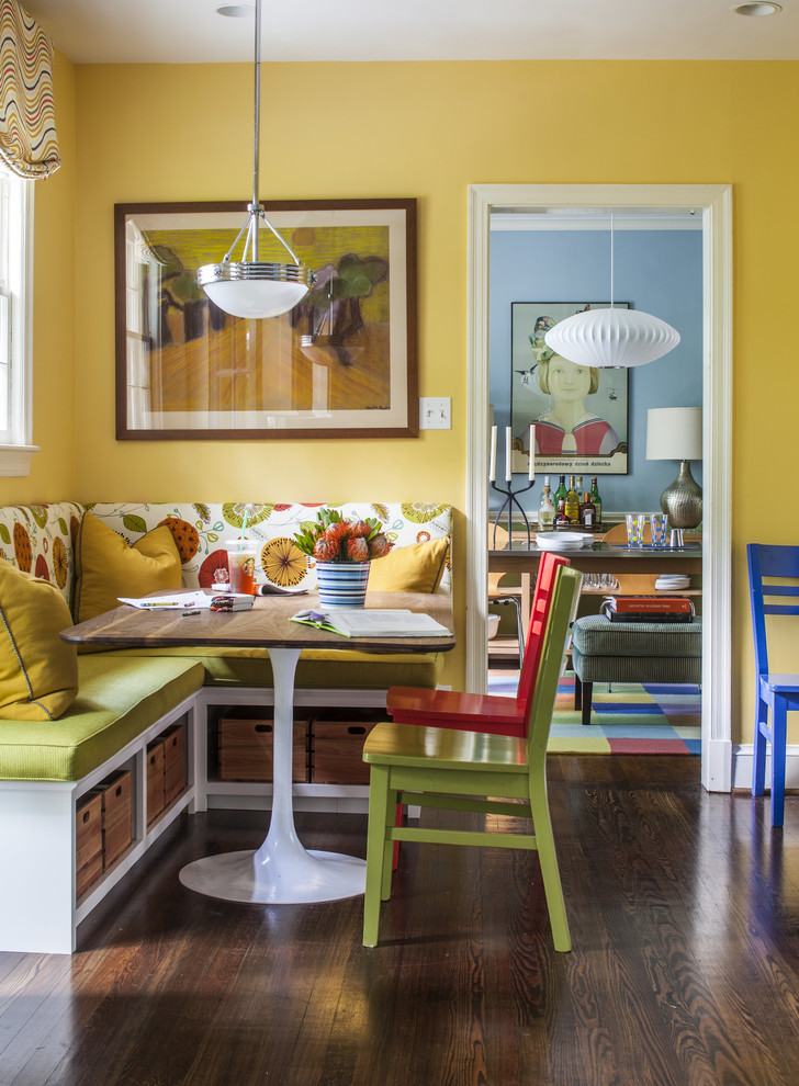 Example of a mid-sized eclectic dark wood floor kitchen/dining room combo design in DC Metro with yellow walls and no fireplace