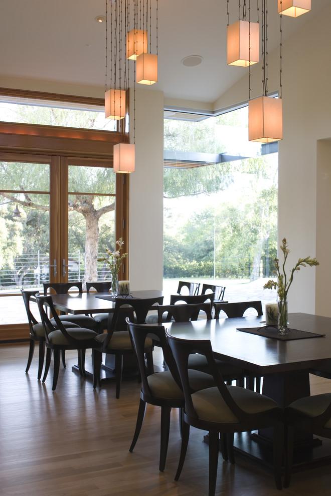 Example of a trendy dark wood floor dining room design in Los Angeles with beige walls