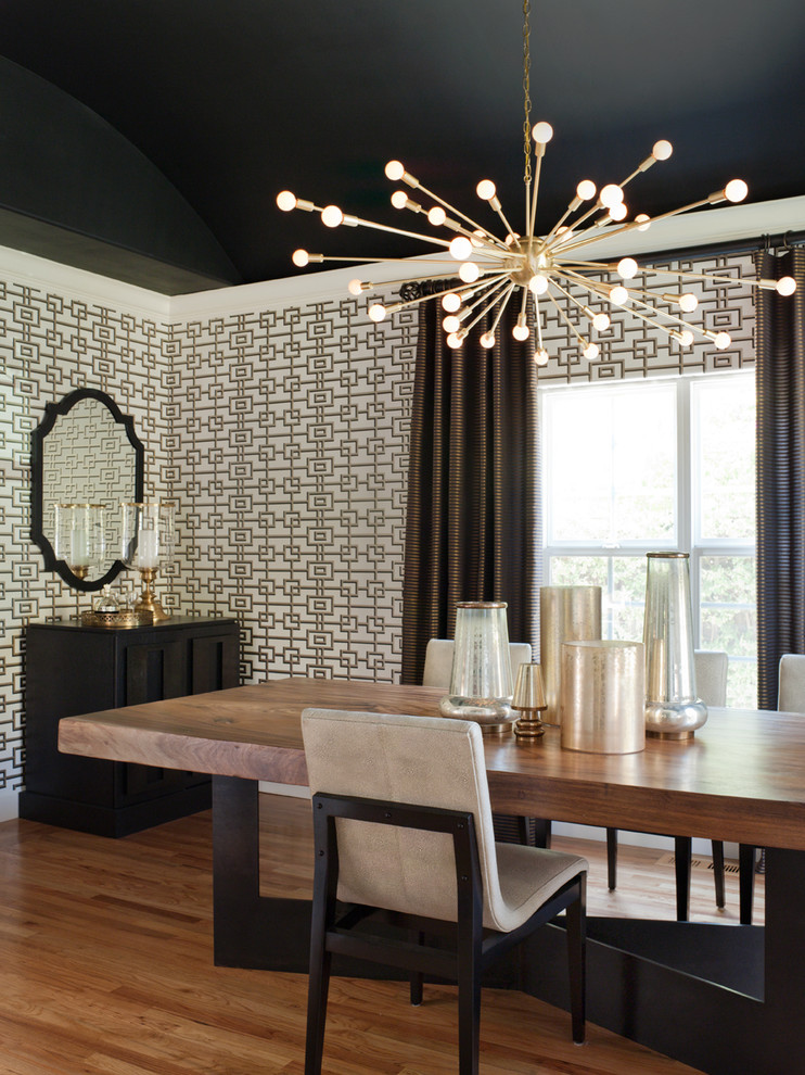 Inspiration for a mid-sized transitional medium tone wood floor and brown floor enclosed dining room remodel in San Francisco with multicolored walls