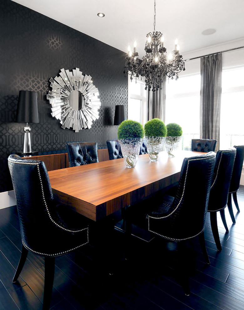 Trendy black floor dining room photo in Other with black walls