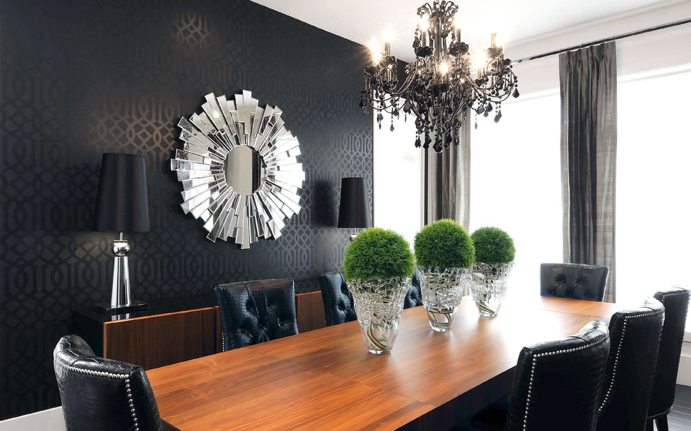 Dining room - contemporary dining room idea in Other with black walls