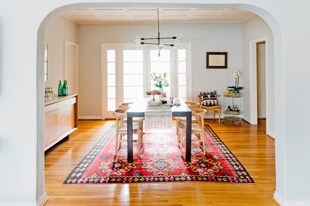 Inspiration for a small transitional light wood floor kitchen/dining room combo remodel in New York with gray walls and no fireplace