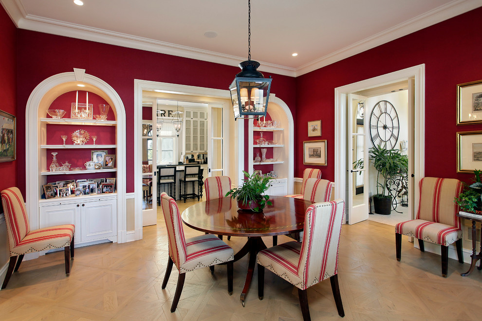 Inspiration for a mediterranean medium tone wood floor enclosed dining room remodel in Chicago with red walls