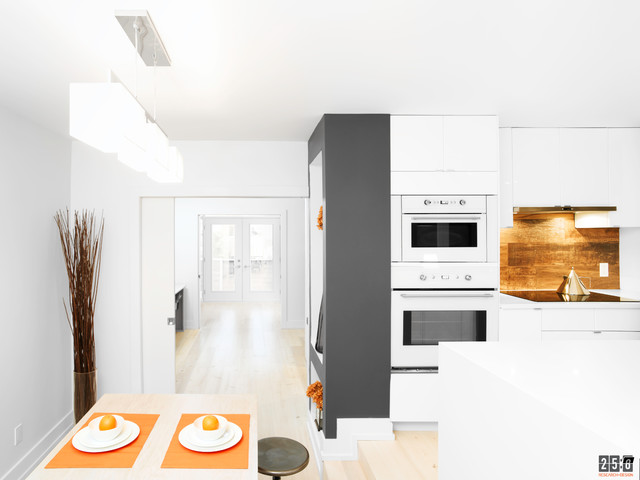 Example of a minimalist dining room design in Ottawa
