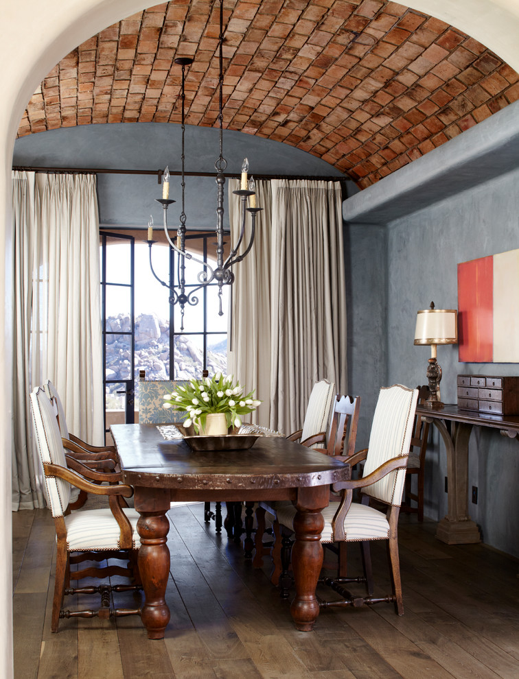 Example of a southwest dark wood floor and brown floor dining room design in Phoenix with gray walls