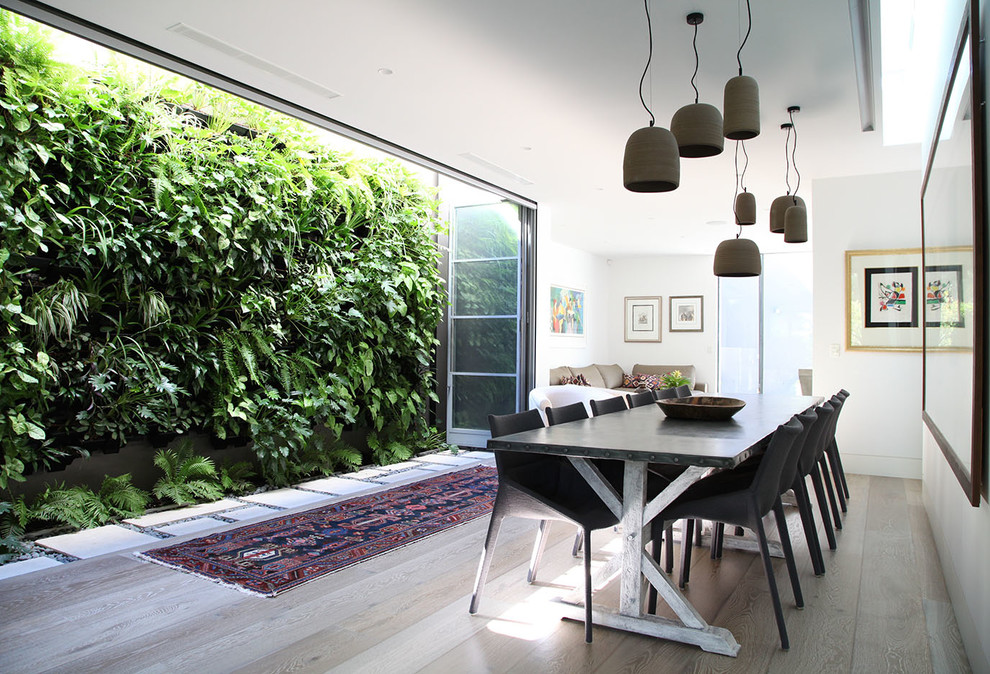 Trendy light wood floor and gray floor great room photo in Sydney with white walls