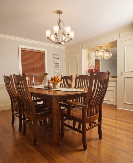 Example of a mid-sized transitional medium tone wood floor enclosed dining room design in Philadelphia with gray walls and no fireplace