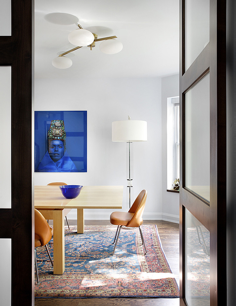 Example of a 1950s dark wood floor dining room design in Chicago with white walls