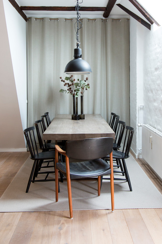 Enclosed dining room - mid-sized scandinavian light wood floor enclosed dining room idea in Copenhagen with white walls and no fireplace