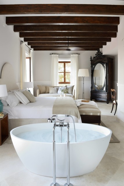 Inspiration for a large farmhouse master bedroom remodel in Barcelona with white walls and no fireplace