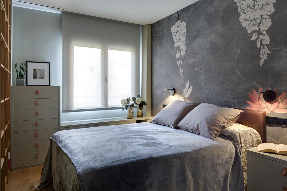 Example of a trendy guest light wood floor and beige floor bedroom design in Alicante-Costa Blanca with gray walls