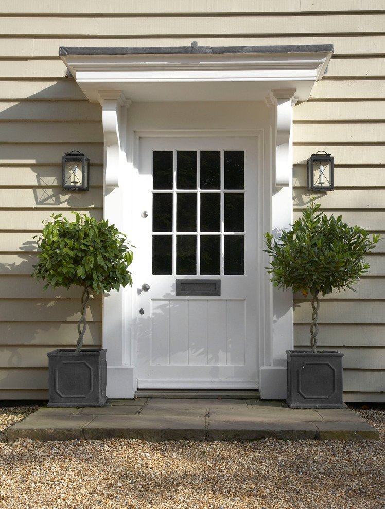 Inspiration for a farmhouse entryway remodel in Wiltshire with a white front door and beige walls