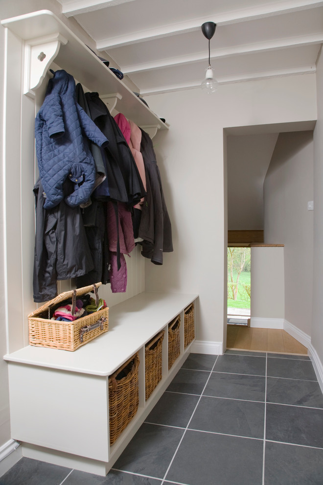 Inspiration for a transitional mudroom remodel in Gloucestershire with gray walls