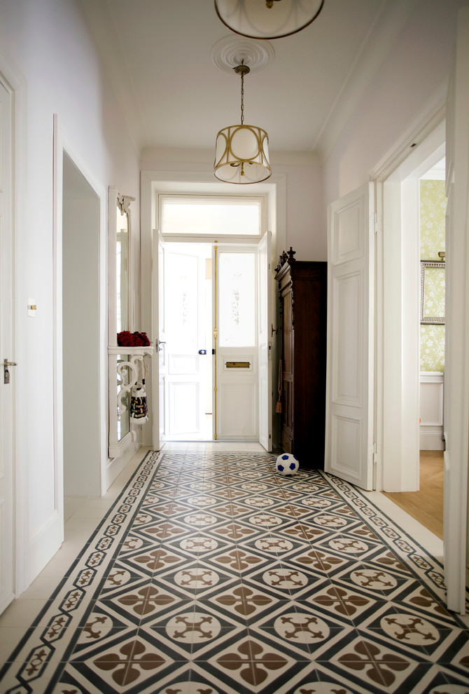 Entry hall - traditional entry hall idea in London with white walls and a white front door