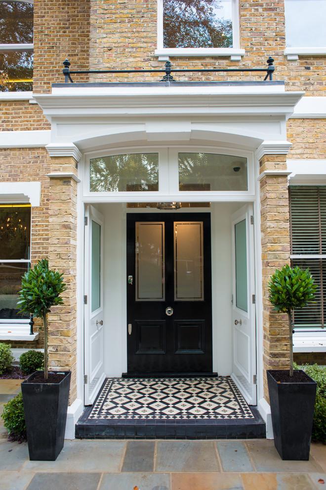 Inspiration for a victorian front door in Berkshire with a black front door.