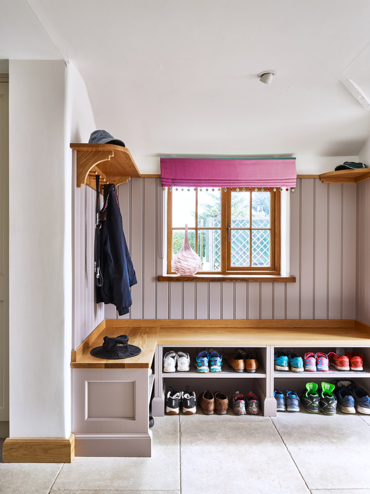 Example of a small country gray floor mudroom design in London with white walls