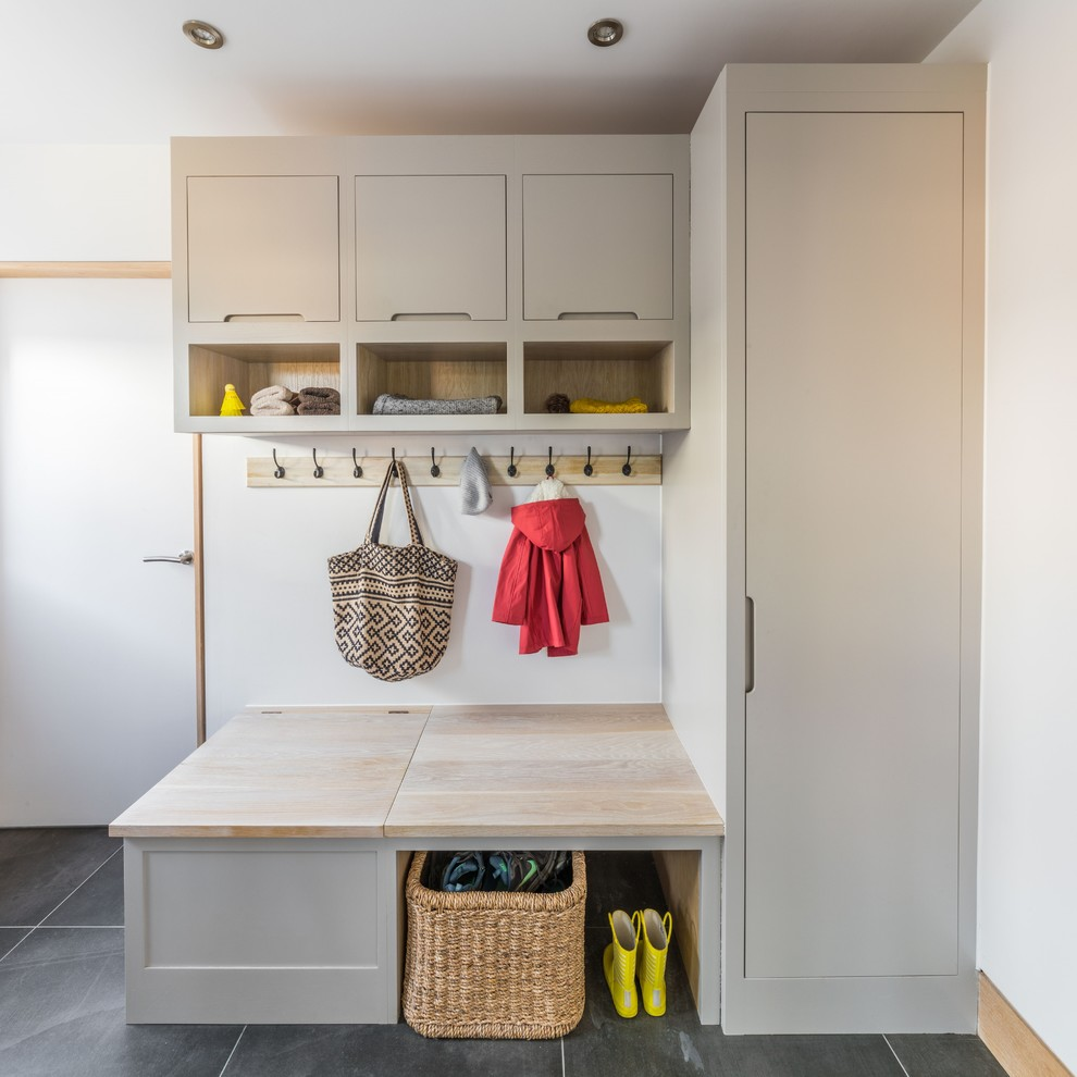 Large trendy ceramic tile and gray floor mudroom photo in Other with white walls