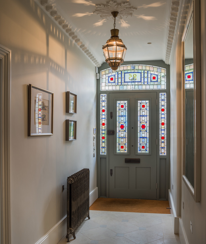 Design ideas for a medium sized traditional hallway in London with grey walls, ceramic flooring, a single front door, a grey front door and feature lighting.