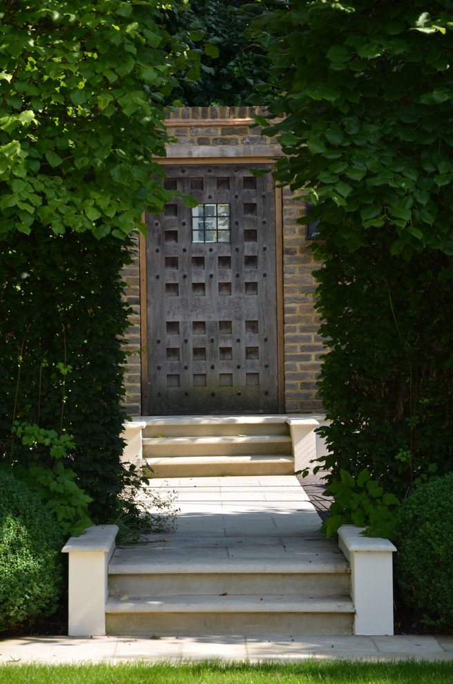 Inspiration for a timeless entryway remodel in London with a medium wood front door