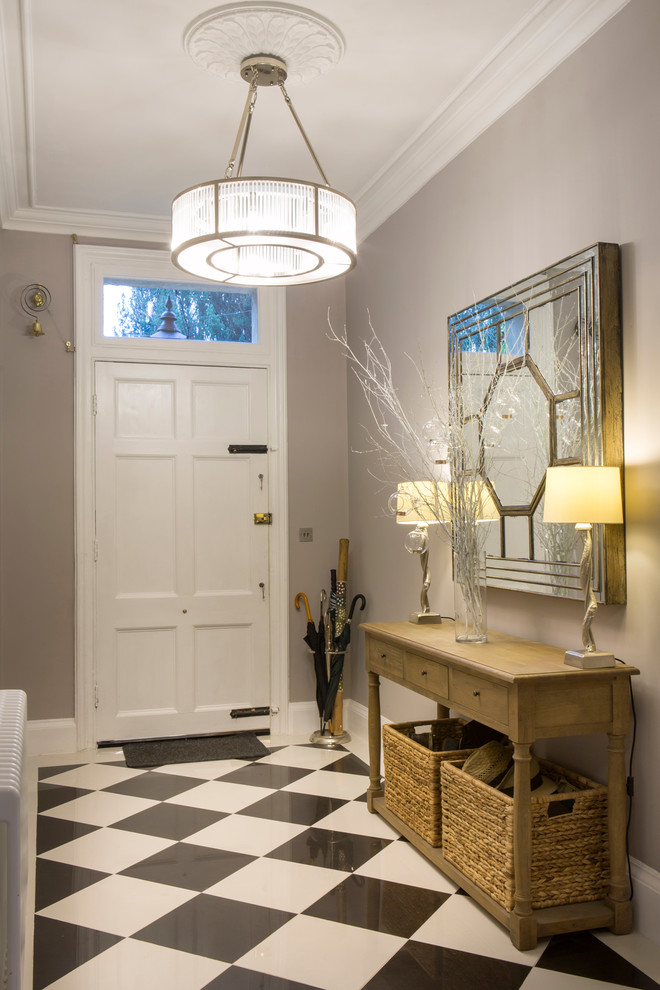 Example of a classic entryway design in Oxfordshire with gray walls and a white front door