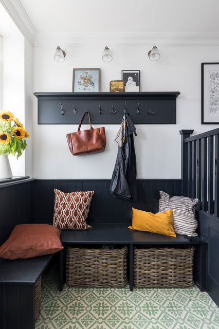 Design ideas for a classic boot room in London with white walls and green floors.