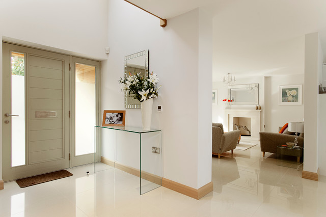 Trendy white floor entryway photo in Dorset with white walls