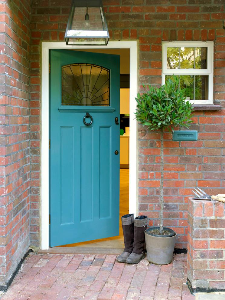Example of a trendy front door design in London with a blue front door