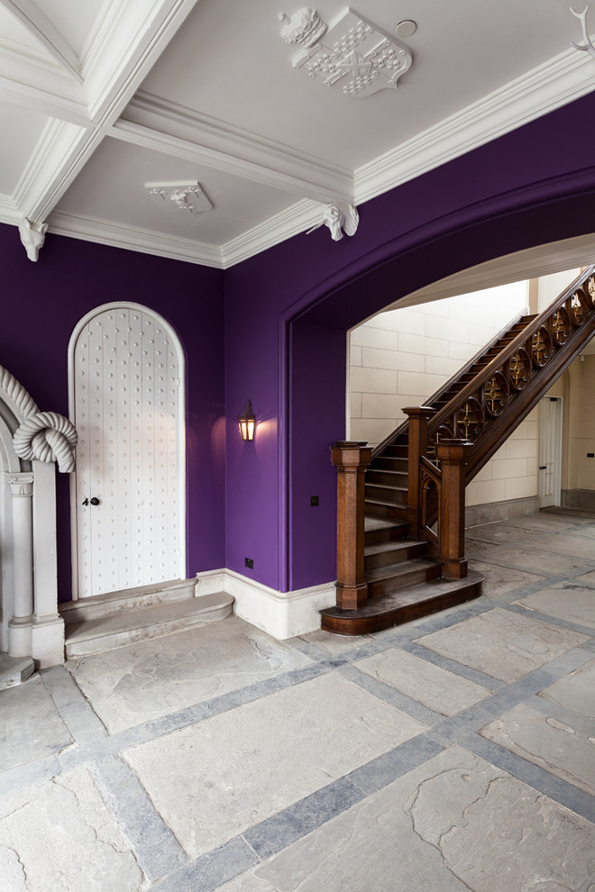 Example of a classic entry hall design in Other with purple walls