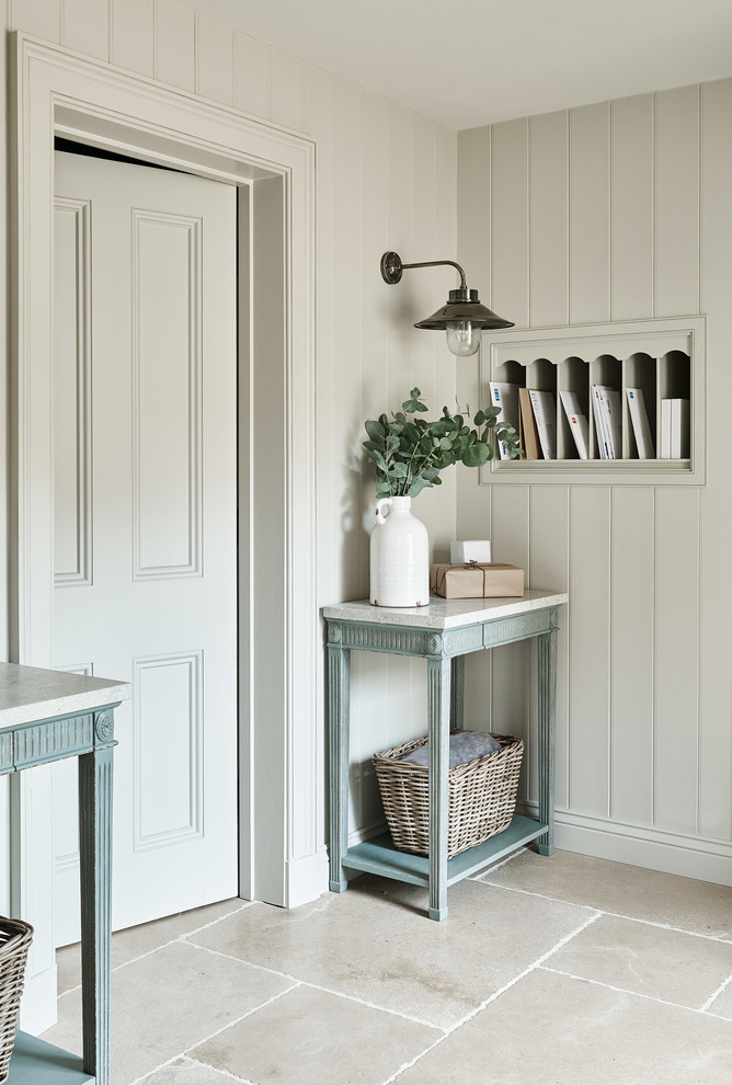 Inspiration for a country entryway remodel in Gloucestershire with beige walls