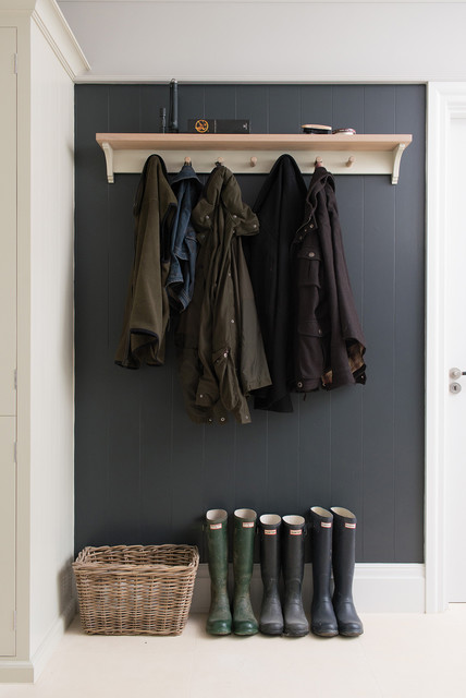 Large trendy mudroom photo in Gloucestershire with gray walls