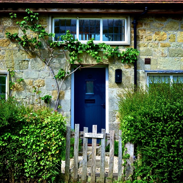 Mountain style entryway photo in Dorset with a blue front door