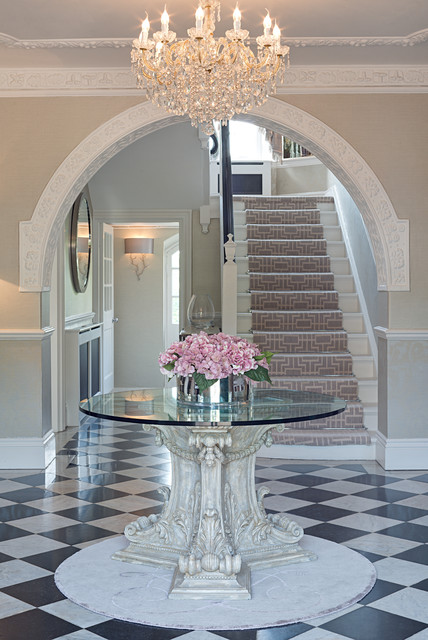 Foyer - large traditional ceramic floor foyer idea in Sussex with beige walls