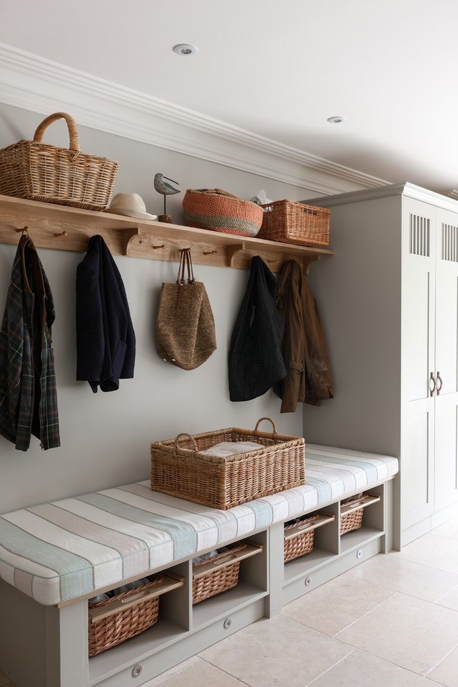 Example of a transitional mudroom design in London with gray walls