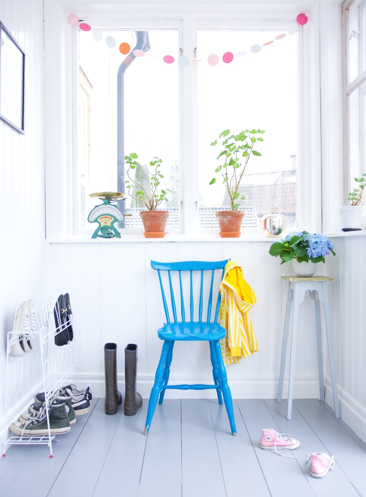 Example of a small danish painted wood floor mudroom design in Other with white walls