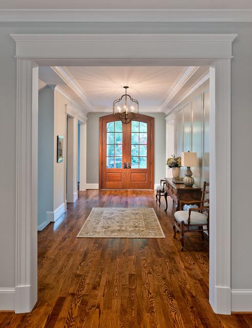 Entryway - large traditional dark wood floor entryway idea in DC Metro with a medium wood front door and gray walls