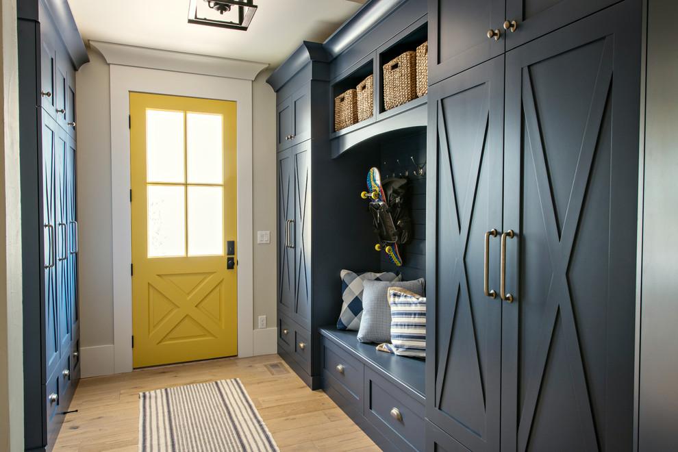 Transitional light wood floor and beige floor mudroom photo in Denver with beige walls and a yellow front door