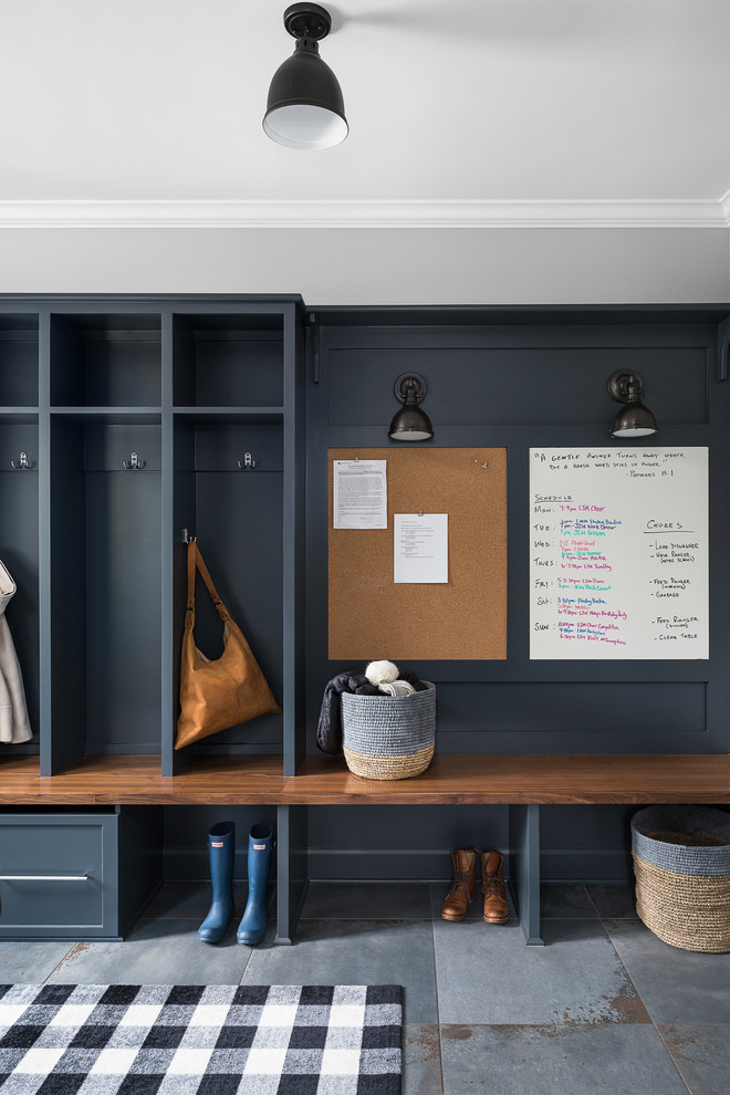 Example of a cottage gray floor mudroom design in Chicago