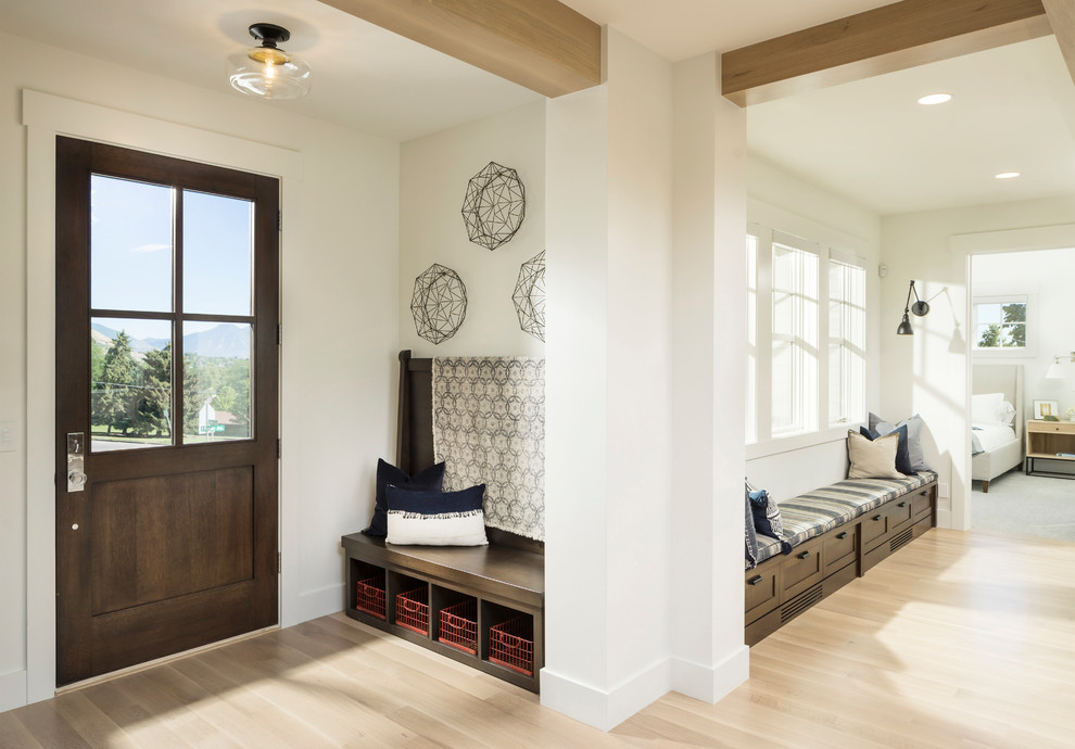 Huge transitional light wood floor and beige floor entryway photo in Salt Lake City with white walls and a dark wood front door