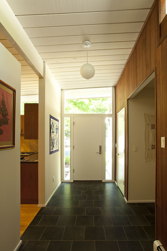 Inspiration for a 1950s slate floor entryway remodel in San Francisco with a white front door