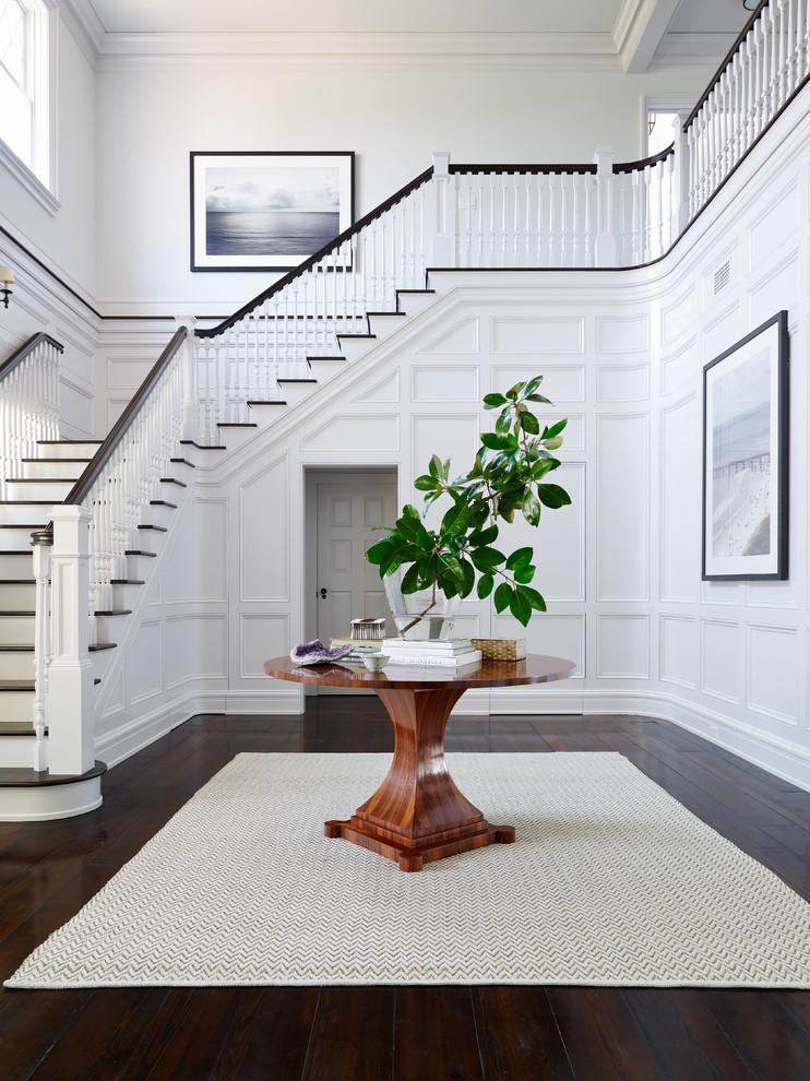 Elegant dark wood floor foyer photo in Jacksonville with white walls
