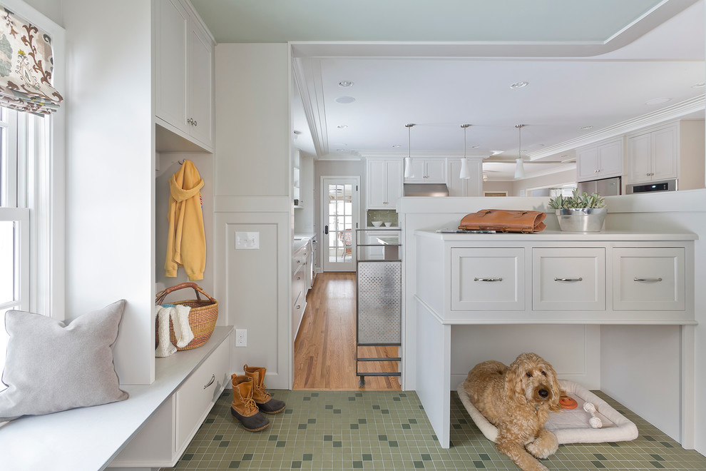 Example of a transitional green floor mudroom design in Minneapolis with white walls