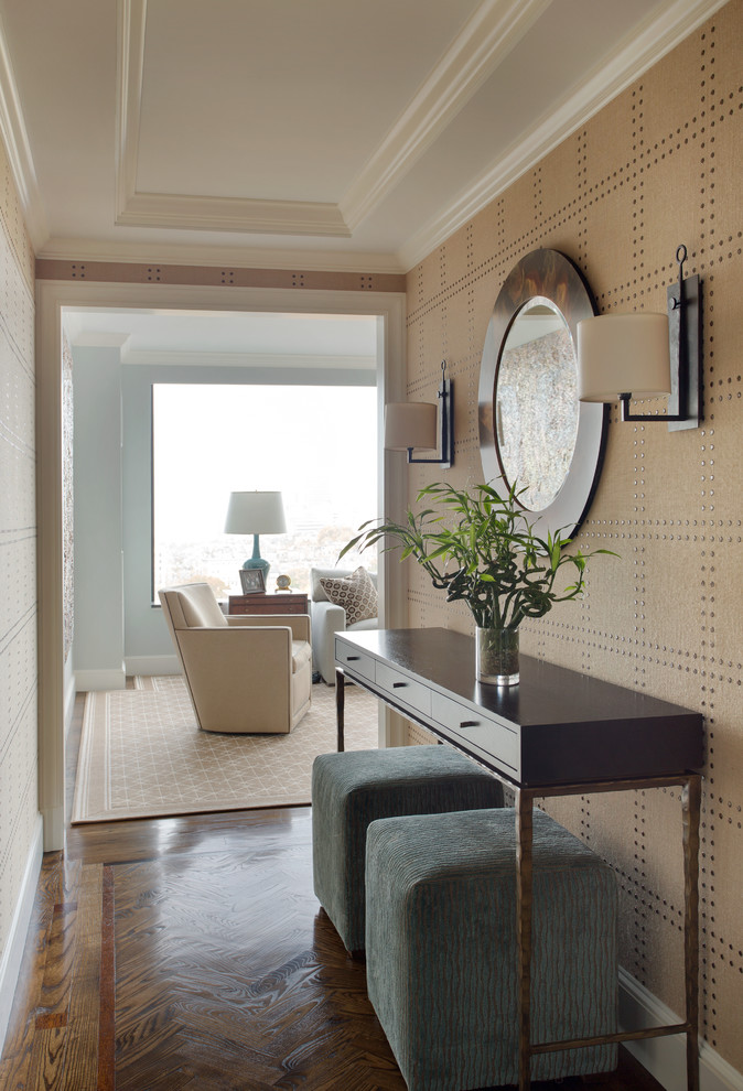 Inspiration for a small timeless medium tone wood floor entry hall remodel in Boston with beige walls