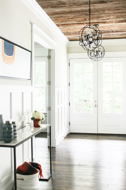 Mid-sized cottage dark wood floor and brown floor entryway photo in DC Metro with gray walls and a white front door