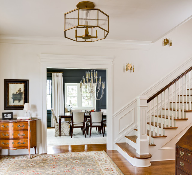 Foyer - large traditional medium tone wood floor foyer idea in Atlanta with white walls