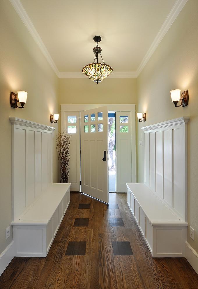 Elegant dark wood floor single front door photo in Austin with beige walls and a white front door