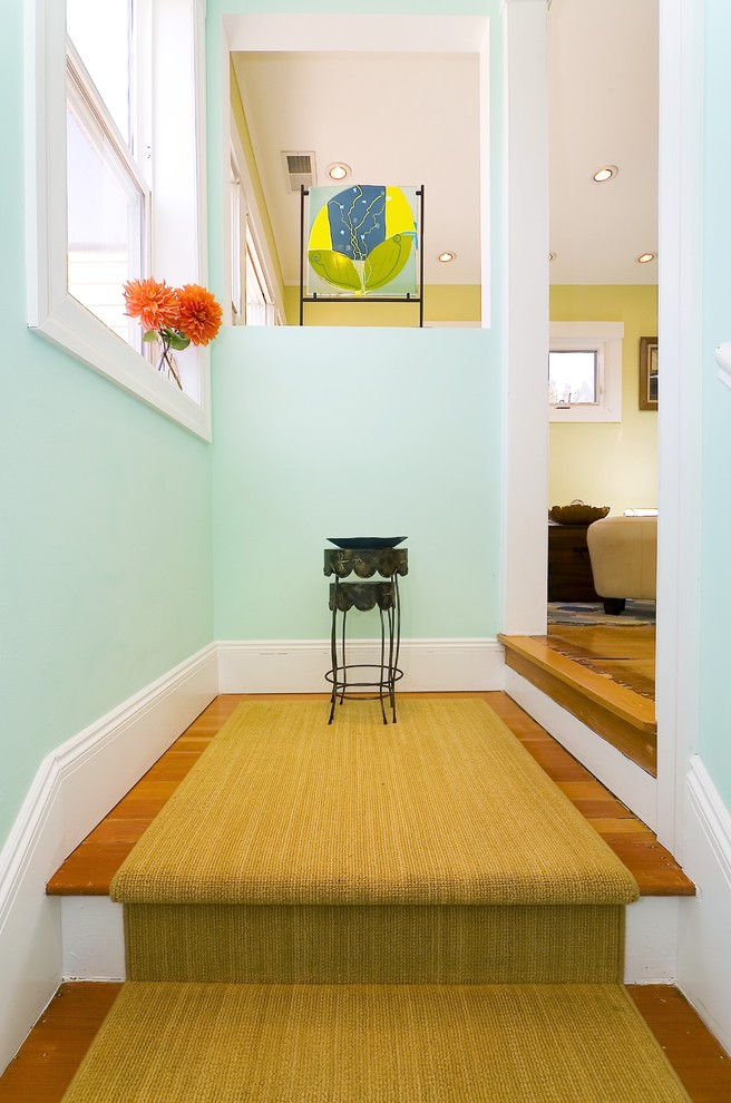 Example of a trendy medium tone wood floor entryway design in San Francisco with blue walls