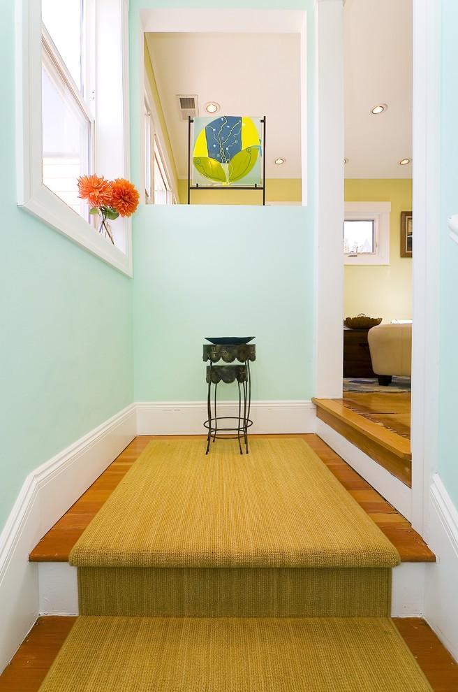 Example of a trendy medium tone wood floor entryway design in San Francisco with blue walls