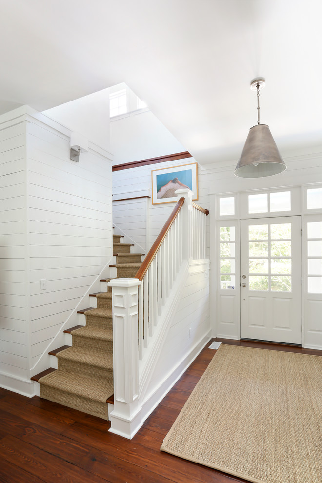 Entryway - beach style entryway idea in San Francisco with a white front door